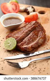 Delicious grilled lamb on chopping board
