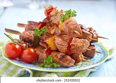 Delicious grilled pork meat and vegetable kebabs