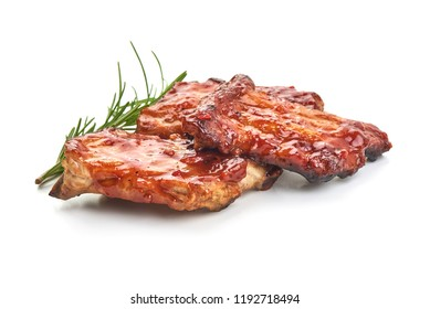 Delicious grilled pork ribs in BBQ sauce with herbs, isolated on white background