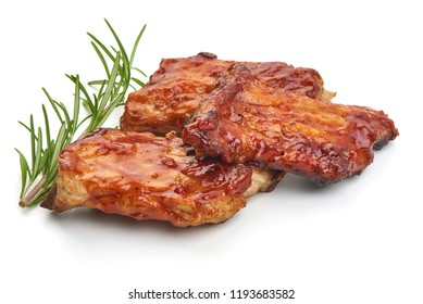 Delicious grilled pork ribs in BBQ sauce with herbs, isolated on white background. Close-up