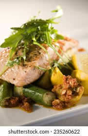 Delicious grilled salmon on a bed of roasted vegetables