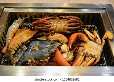 Delicious grilled seafood platter shrimp, squid, crab, Flathead lobster.
