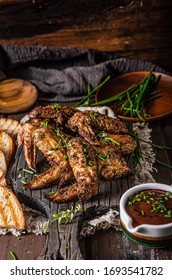 Delicious grilled wings with barbecue sauce and grilled bread