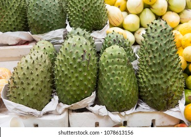 Delicious guanabana for sale in tropical fruit market of South America.