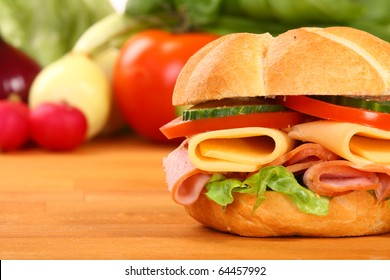 Delicious ham, cheese and salad sandwich, on a wooden board