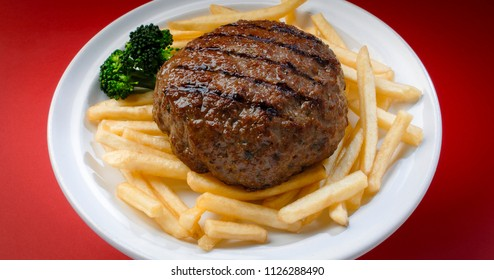 Delicious hamburger plate with french fries and broccoli