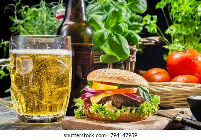 delicious hamburger served with beer