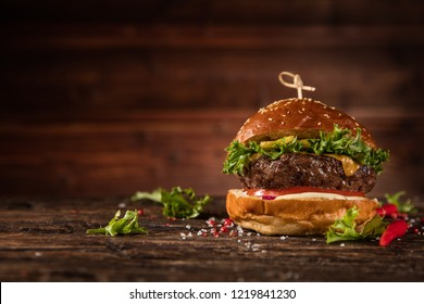 Delicious hamburger, served on wood. Free space for text