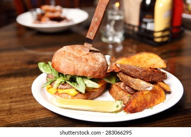 Delicious hamburger with wedge cut french fries.