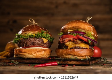 Delicious hamburgers with fries, served on wood. Free space for text