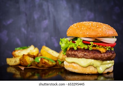 Delicious hand made burger on dark background. Close view