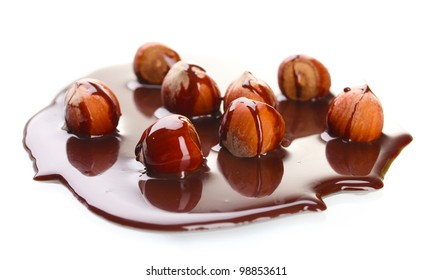 delicious hazelnut and chocolate syrup isolated on white