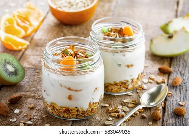 Delicious healthy American breakfast made of granola, yogurt and fruits. Classic US morning meal. Traditional healthy snack.