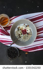 delicious healthy breakfast bowl with granola and fresh fruits