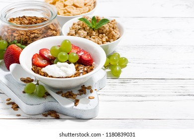 delicious healthy breakfast with fruits, granola on white background, horizontal