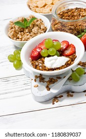delicious healthy breakfast with fruits, granola on white background, top view
