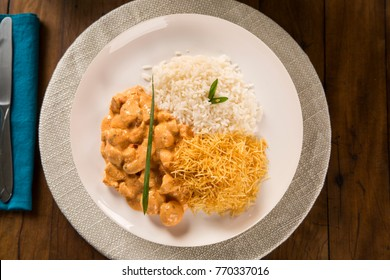 Delicious healthy food with chicken strogonoff with rice and french fries on dish. View from the top.