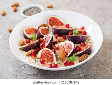 Delicious and healthy oatmeal with figs, almond and chia seeds. Healthy breakfast. Fitness food. Proper nutrition.