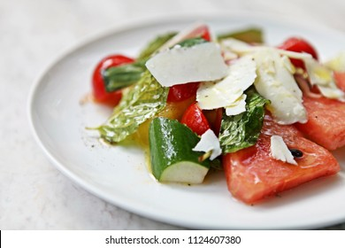 Delicious and healthy Raw Food:Cool, Refreshing Watermelon, cherry tomato, cucumber and parmesan cheese Salad. Topped with mint and drizzled with extra virgin olive oil by a professional Starred Chef.