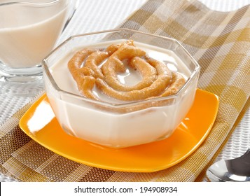 A delicious and healthy snack called Dood Jalebi, famous in asian countries, made with wheat flour, sugar syrup and serve with hot milk.