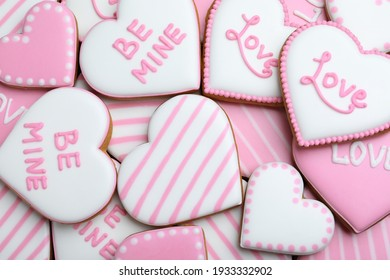 Delicious heart shaped cookies as background, top view. Valentine's Day