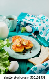 delicious, hearty and healthy breakfast, omelet, scrambled eggs in the form of cupcakes with ham, cheese, spices, lettuce, black tea and milk on a wooden background