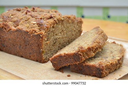 Delicious, Home baked Banana Bread, Sliced on a Cutting Board on a Wooden Kitchen Table