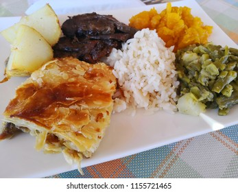 delicious home cooked farm roast meal on white plate