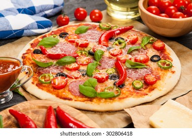 Delicious home made pizza on wooden background