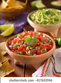 A delicious home made salsa pico de gallo with tomato, onion, lime, cilantro, and jalapeno pepper.
