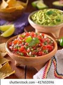 A delicious home made salsa pico de gallo with tomato, onion, lime, cilantro, and jalapeno pepper.