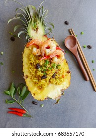 Delicious homemade authentic Thai spicy fried rice / Pineapple Fried Rice / Made with fresh ingredients,pineapple,white rice,pepper,chili paste,red chili,turmeric,shallots,garlic,fresh shrimps