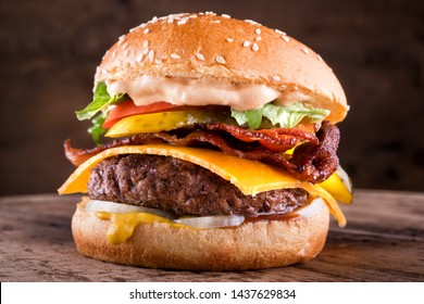 A delicious homemade bacon cheeseburger with real cheddar cheese, lettuce, onion, tomato, pickle, mustard, ketchup and burger sauce.