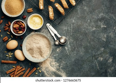 Delicious homemade biscotti and baking ingredients. Food background with copy space.