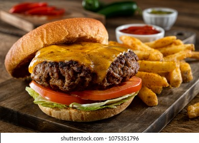 A delicious homemade burger with real cheddar cheese and black pepper seasoned french fries.