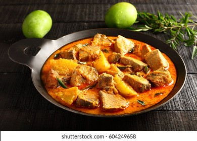 Delicious homemade butter fish curry with coconut,mangoes and spices,from Asian cuisine.