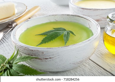 Delicious homemade cannabis butter with marijuana leaf garnish.