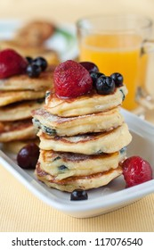 Delicious homemade cheese pancakes with berries