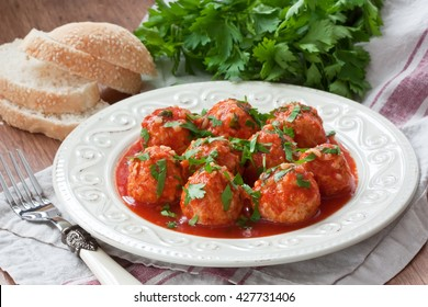 Delicious homemade chicken or turkey meatballs with rice, vegetable and tomato sauce/Meatballs with tomato sauce
