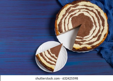 Delicious homemade chocolate cake with cottage cheese Zebra (Marble cake). Piece is cut out of the cake. Tasty breakfast. Top view