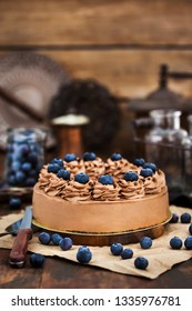 Delicious homemade chocolate cheesecake decorated with fresh blueberries
