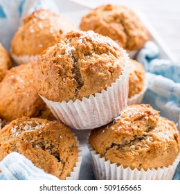 Delicious homemade coconut cinnamon muffins on old white tray. Healthy food concept.