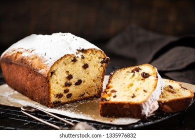 Delicious homemade cottage cheese and raisins loaf cake on dark rustic wooden background