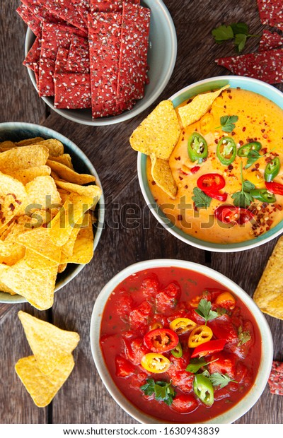 Delicious homemade dips and Tortilla chips and crackers