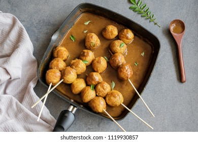 Delicious homemade ever popular Hong Kong cuisine / Hong Kong Curry Fishball / Made from fresh Spanish Mackerel fish paste, formed into fishball, deep-fried and cooked in thick curry gravy