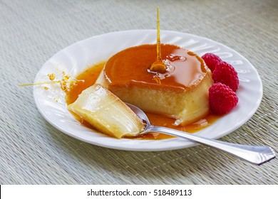 Delicious homemade Flan dessert or creme caramel dessert with raspberries