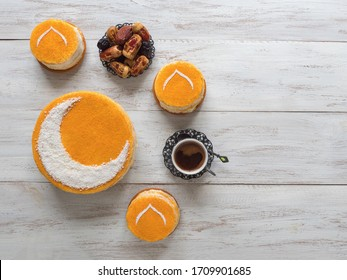 Delicious homemade golden cake with a Crescent moon, served with black coffee and dates. Ramadan background, copy space.
