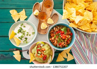 Delicious homemade guacamole and tomato salsa with tortilla chips