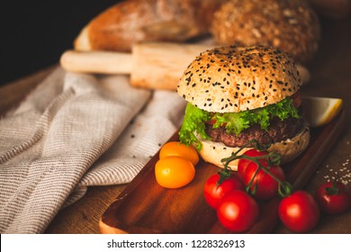 Delicious homemade hamburger with fresh vegetables in the kitchen ready for serve and eat