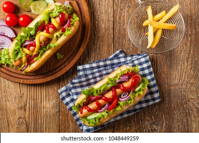 Delicious homemade hot dogs. Served with chips. Top view.